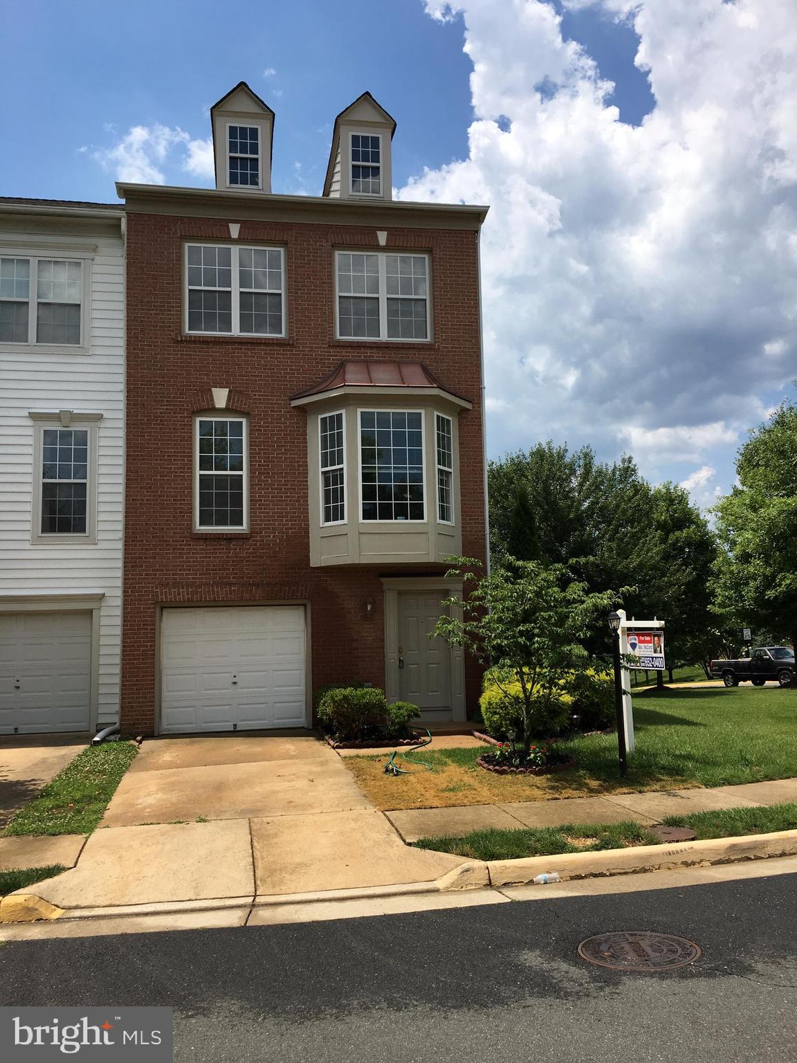 This is a large end unit and one of the biggest in the neighborhood. Freshly painted and new granite countertops. All three levels bump out. Large bedrooms, spacious closets, and wide staircases. Hardwood floors on main level w large eat in kitchen w breakfast area and room at counter for two stools, spacious dining room and large living room w fireplace and bay window. Den w walk out to deck. Lower level has a bedroom, bathroom and large rec room, as well as access to one car garage.