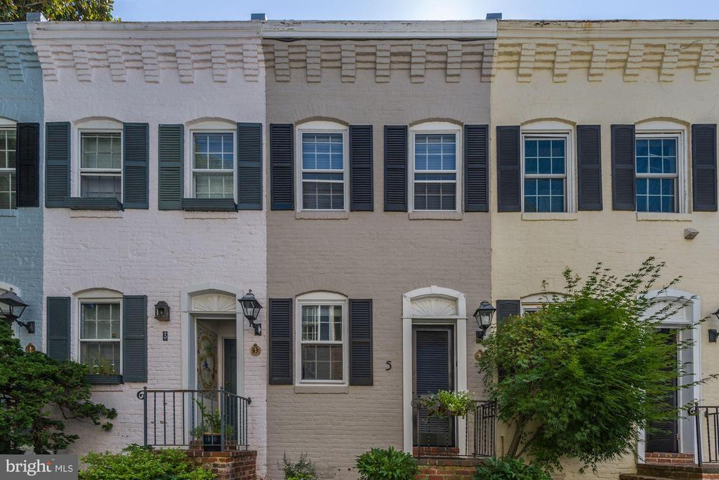 A Georgetown Gem!  An all-brick row house for the price of a condo and with no condo fees is now for sale on quaint Pomander Walk.  This home has been totally renovated with 2-zone central air conditioning, new hardwood floors, open kitchen with granite counters, dishwasher, Liebherr refrigerator, gas fireplace, and washer/dryer closet.  The main level features the living area with garden access, kitchen, and maximized storage areas.  The upper level provides a large bedroom with built-in desk, walk-in closet, and a full bath.  Pomander Walk is across the street from Volta Park (a city park with country club amenities:  swimming pool, tennis courts, basketball courts, playing fields, and a playground.