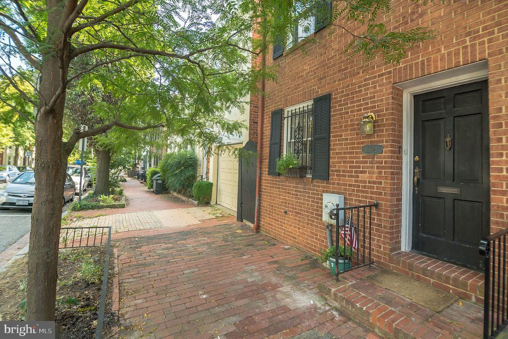 Georgetown living at its best! This charming 3 bedroom /3 bath semi-detached rowhouse features a modern kitchen, open dining and living area, expansive sunroom or main-level 3rd bedroom, & large deck perfect for entertaining. 2 bedrooms and 2 baths upstairs, including an ensuite master. Washer/Dryer. Steps to shops, restaurants, Volta Park, library, & public transportation. Easy street parking.