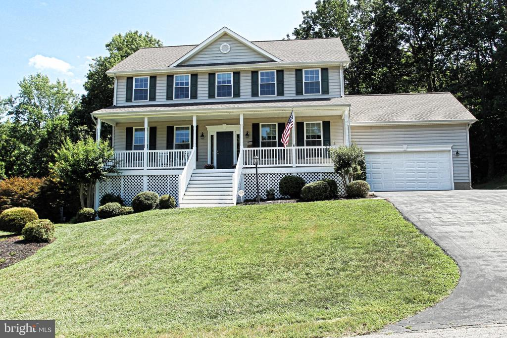 Gorgeous 2 story colonial home with a welcoming front porch.  This home will have many cherished memories for the new owners.  As you open the front door you will be amazed with the upgrades in this home.  The main level has a formal living room, dining room, 1/2 bath, family room with a fireplace and the kitchen has been completely remodeled with white cabinets, stainless steel appliances, granite countertops and a huge pantry.  The hardwood floors are picture perfect.  This open concept kitchen will be a wonderful gathering spot for entertaining.  Sliding doors from the kitchen area open to a new maintenance free deck.  Imagine sitting out and enjoying a cup of coffee.  Private backyard with a natural tree line.  The second level of this home has a large master suite with private bathroom, soaking tub, separate shower and double vanity sinks.  There is an upstairs laundry room, and 3 additional bedrooms and a bathroom. All of the bedrooms have large closets.   Lower level has a finished family room, game room and bar area with another full size bathroom.  Plenty of built in shelving in the lower level storage area.  This home features a new 50 year architectural shingled roof, energy saving solar panels, newer HVAC, appliances, high efficiency water heater and more.  There is a large oversized garage with built in storage and a large shed on the property for additional storage.