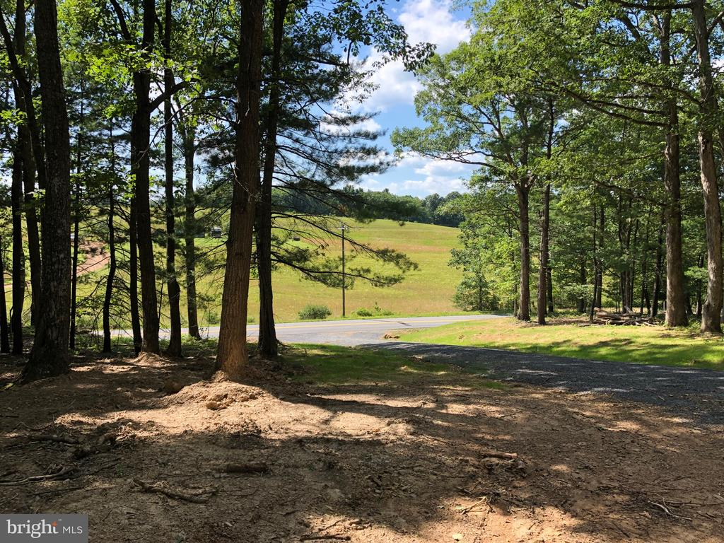 Great Building Lot just minutes from downtown.   This 6.156 acres is unrestricted and has great access.   Hunt, build, ride your ATV, or camp.   Mobile/double wide allowed.  Driveway installed.