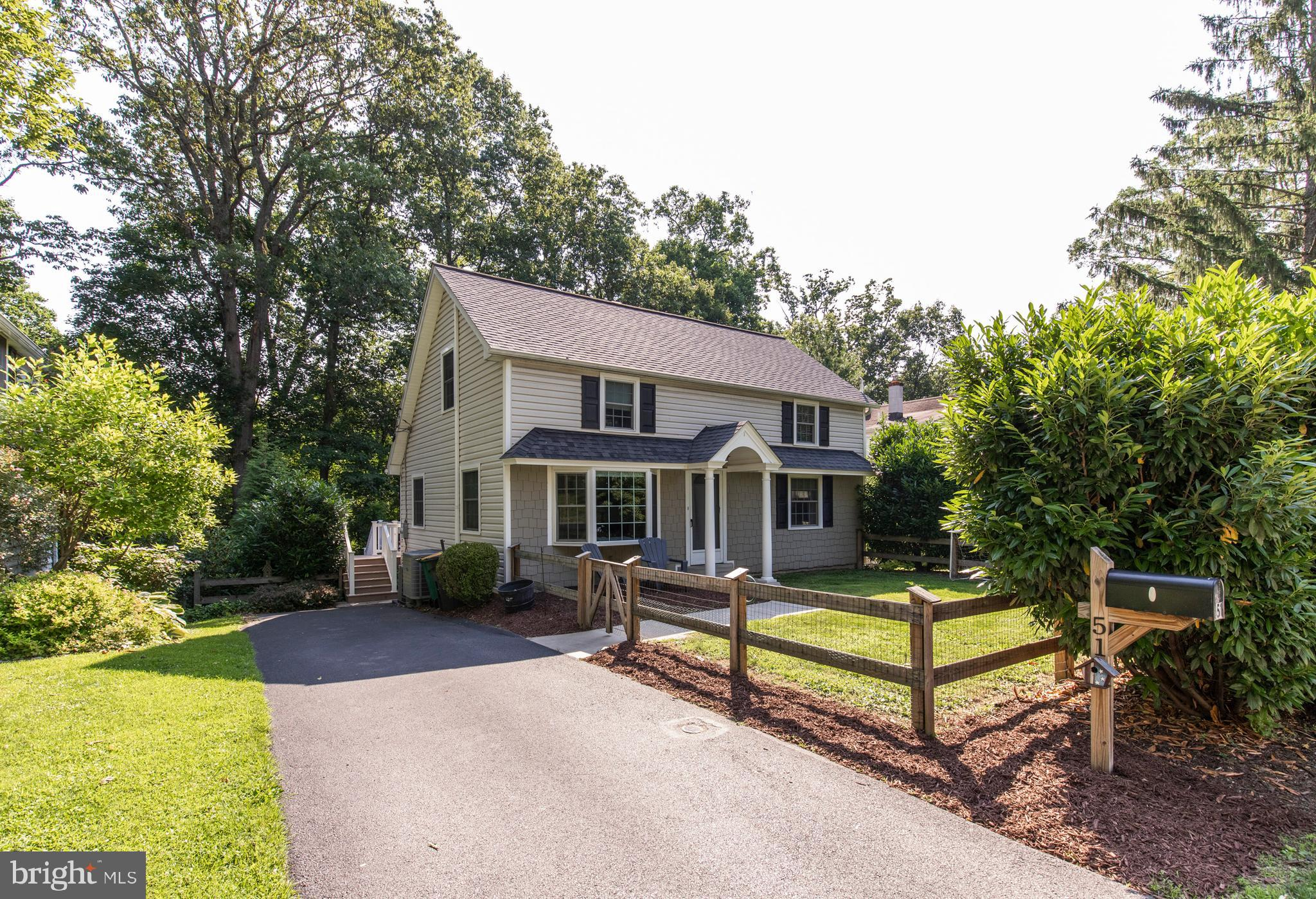 This immaculate cape cod invites comfort with 4 bedrooms, 2 baths and stylish finishes. You'll also enjoy a perfect setting for relaxing and entertaining on the spacious Trex deck and the private fence-in yard. Plenty of natural light flows throughout this home which features a bay window with window seat in the living room; an intimate dining room with chandelier and sliding glass door the deck; newer kitchen with 42~ white cabinetry, granite countertops, subway tile backsplash, stainless steel appliances, gas stove, recessed lighting, dishwasher and a built-in space saver microwave. The walkout, daylight basement provides additional living space with family room and a laundry/storage room. There are two main level bedrooms that provide access to the updated hall bath with vanity, tub, mirrored medicine cabinet and lighted wall sconces. Upstairs you will find two additional spacious bedrooms and full bath. Other special highlights include a 2-zoned HVAC system, 3 car parking in the private driveway, 200 amp electric, front and back fenced-in yards and an ideal location within a very close proximity to Berwyn Train Station, shops and restaurants.