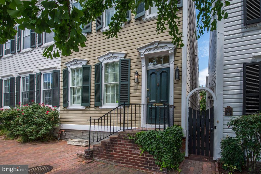 A rare Georgetown Victorian townhouse retaining its original architectural features and tastefully finished in Farrow & Ball colors throughout.  High ceilings, hardwood floors, central air conditioning, great light and a private outdoor space with brick patio and easily maintained planting. The main level features an entry hall, living room with wood burning fireplace, separate formal dining room, wet bar/butler~s pantry, eat in gourmet kitchen with home office space and half bath located off the hall. The second level features three bedrooms and two full baths. The owner~s suite en-suite bath has just been renovated and features teak flooring and a marble shower. The second bathroom has also been renovated and features teak floors, a tub/shower combination with a marble surround. There is substantial basement storage. The row home offers a quiet setting yet is convenient to all Georgetown has to offer including restaurants, shopping and nightlife.