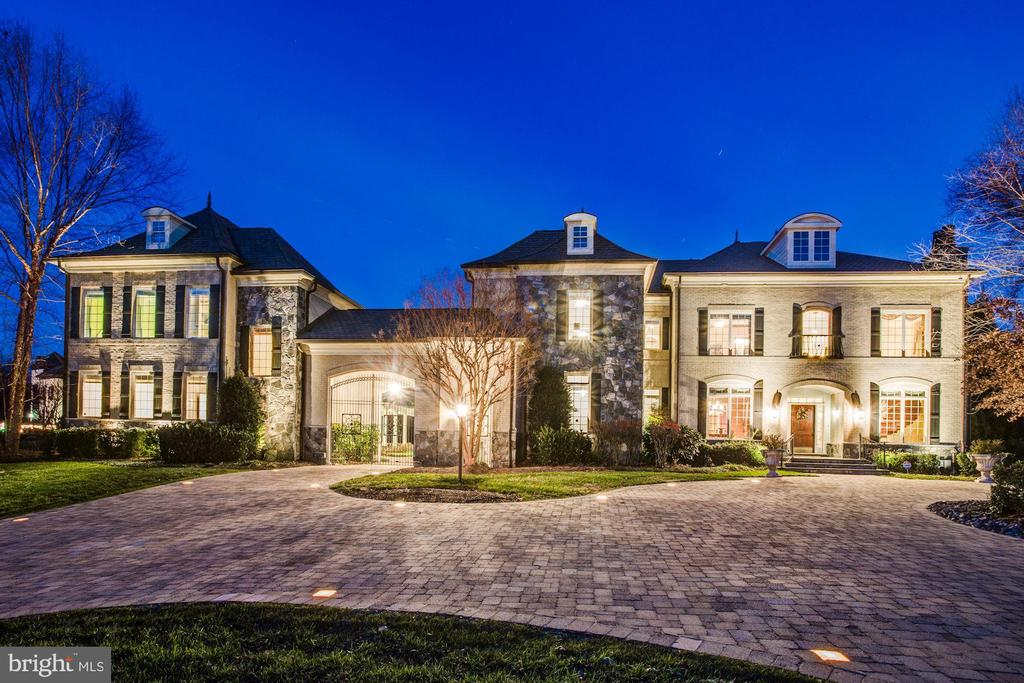 ONE MARQUETTE:  This majestic estate spanning 11,000+ square feet and encompassing 7 bedrooms and 7.5 baths is sited high on 1.73 acres in one of Washington D.C.~s most popular suburbs.   Built in 2006 as the model home in its prestigious enclave, the property is outfitted with every Platinum option and Luxury feature offered by the builder Keswick Homes. The entrance opens to a two-story reception hall nearly encircled by a graciously curving staircase. Formal living and dining rooms are positioned off the foyer, as is a private office with mahogany trims, coffered ceiling and fireplace.    The crown jewel of the property is the fabulous gourmet kitchen complete with butler~s pantry, expansive island and top-of-the line appliances highlighted by the beautiful red Aga cooker range.    Adjoining the kitchen, a sun-drenched breakfast salon encourages informal dining, while the family room with 22-foot vaulted ceiling and cozy sunroom beyond offer beautiful relaxation. These spaces also provide access to a covered patio, outdoor lounging and dining areas, pergola and stone fireplace.    Upstairs, the owner~s suite makes a bold statement with its separate sitting room, private balcony and luxurious spa-like bath.   Three additional bedrooms, each with en suite bath, along with an open family/study room grace this level.    The lower Club level begins with an open recreation room anchored by an expansive wet bar with 300-bottle wine cellar. Displaying optimal flow for entertaining, this level also includes fitness and billiards areas, a media room/cinema, lounge, bonus room and full bath with steam shower and sauna.    A separate two-bedroom guest/in-law suite over the garage provides additional accommodations.   Public Water/Sewer, rare for Great Falls, and sited on the border of McLean.