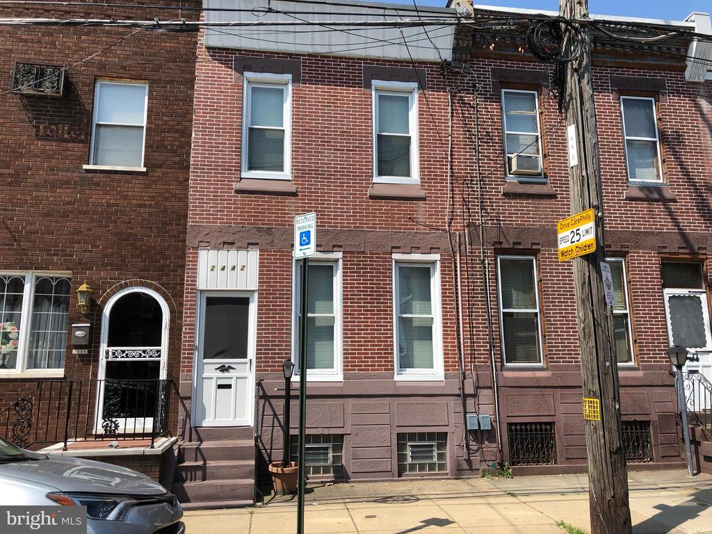 Large Straight-thru Brick Row in Convenient Fishtown!  Minutes to Center City, Including all that Historic Philadelphia has to Offer!  Foyer entry w/French Door, Large Living Room w/Ceiling Fan- Most Replacement Windows T/O, Large Formal Dining Room, Huge Eat-in Kitchen w/Lots of Cabinets and Counter Tops- Newer Gas Stove, w/Built-in Microwave-Dishwasher and Trash Compactor (?works) - Exit to Rear Fenced Yard. 2nd Floor  Exterior Rear Bay  Sided; Upstairs - 3 Bedrooms, Main has Wall to Wall Closets - Large Hall Linen Closet; 2nd Bedroom has Double Closet w/Shelves, w/w Carpet.  High Ceilings Throughout- Downstairs is Huge, Unfinished Basement w/Lots of Built-in Storage Closets - Glass Block Windows - Gas H/W Heat - Gas H/W - Separate Room in Rear.  Washer and Gas Dryer stay.   BEING SOLD 'AS-IS'!