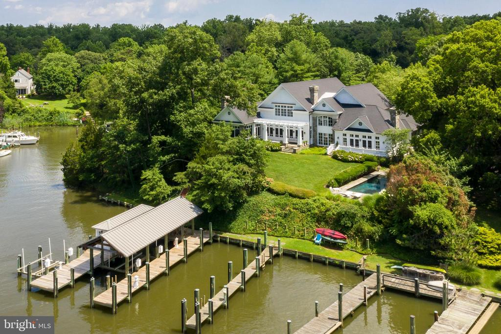 Annapolis Camelot exclusive waterfront, one of the finest in Annapolis, is located in the lush Melvin Road enclave where Little Aberdeen Creek branches off the South River.  The spectacular, custom-built Maryland Manor House is sited perfectly on 7.9 acres of one of the most prominent points of land on Melvin Road. Designed by the notable architect, Scarlett Breeding, and built by West River Builders, Silver Maple Manor offers timeless features and a lifestyle unlike any other.  beautiful tailored gardens, a heated in ground salt-water pool, a pool house, covered screen porch, three (3) stall barn, ample acreage for horses, fields, three (3) deep water piers and a Yachtsman~s dream boathouse on the protected Little Aberdeen Creek.  A perfect spot to enjoy all the magical seasons of living on the South River. You know you~ve arrived once you turn onto the graceful, winding driveway, lined with Silver Maples. Flowering azaleas, and ornamental grasses overflow from the gardens. The estate~s crisp white facade quickly comes into view~just as the verdant landscaping provides a natural camouflage and ensures total privacy for your weekend - or full time - escape. Perfect for holiday celebrations, weekend house parties, and all types of celebrations, the Manor was designed for entertaining on a large scale.  The gracious proportions of rooms, its elliptical Great Lawn perched by the water's edge; a stunning screened porch and the lovely outdoor dining area offer an easy flow for dozens or even hundreds of guests.  And this quiet sanctuary offers surprisingly close proximately to DC and Baltimore and an easy 3.4 miles drive to downtown Annapolis.