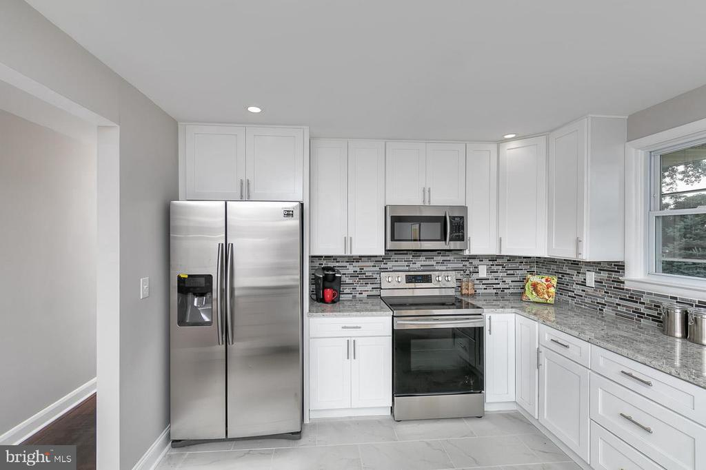 Gorgeous Rancher with 4 bedrooms and 2 Modernly Designed bathrooms, All new Cabinets, SS appliances, Granite Counters, Hardwood Floors, Large Basement, Parking Pad, Large back Yard, and Washer/Dryer....Seller is Motivated to Sell!!!