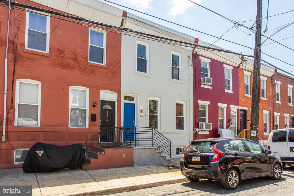 Welcome to this beautiful home that has been completely updated in the heart of thriving Point Breeze.  Upon entering you'll immediately notice the quality of the workmanship. The spacious living room features an exposed brick wall and beautiful hardwood floors that flow throughout.  The stunning kitchen features quartz countertops and stainless steel appliances.  Additionally you'll find a powder room and laundry room on the 1st floor which leads out to the enclosed private patio area. Step upstairs to find a master suite with a gorgeous full bath, 2nd bedroom and a beautiful hall bathroom.  This is the home you've been waiting for!