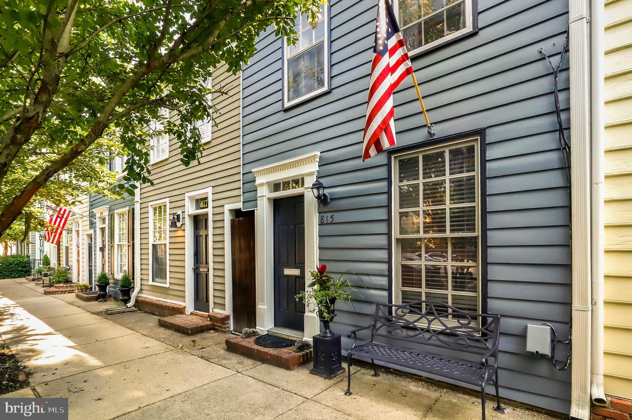 *off street parking in the back yard, gate would need to be changed. Owners still have all of the tricks for the parking pad that could be put back* Beautiful 1900 Victorian, historic townhome in Old Town Alexandria.  6 blocks to Braddock Rd. Metro, 6 blocks to the waterfront, metro bus stops close by.  Surrounded by history, entertainment, dining, and convenience.  Original wood floors, beautiful patio with pergola, fully fenced back yard with an alley for easy access.  Enjoy dining and entertaining in privacy in the backyard, built-in grill.  Updated bathrooms and kitchen.   New outdoor fencing, new exterior landscaping, new trees, painted exterior, outdoor bar, and drill area. **You can add a parking space in the back within property lines**