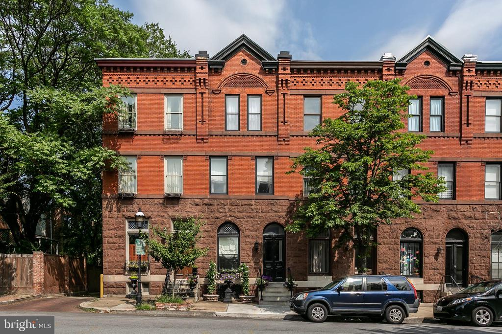 OPEN HOUSE THIS SUNDAY 8/25 12-2:30PM. A Bolton Hill jewel of a home with stunning custom ironwork and brownstone facade plus off-street parking for two cars! Surrounded by three parks, Maple Leaf, Sumpter and Wilson Street Parks and conveniently located near Penn Station to catch the MARC Train to DC, Amtrak to Philly & NYC, Hopkins Shuttle, MICA, U of Baltimore, Peabody and many restaurants and cafes, dog park and just overall amazing neighbors and community. Come see why everyone loves Bolton Hill! So many original details including beautiful, 4 original victorian mantels, gleaming pine wood floors, skylight, exposed brick, french doors, spacious center staircase with newel post and balusters, stained glass in living room, window and door trim and much more. This home seems much larger in person than it appears on paper. 4 Bedrooms, plus bonus study, nursery, gym or dressing room, 2 Full Baths plus a first floor half-bath, a finished lower level family room, play room or space for your gym with brand new plush carpet. Gourmet kitchen with Jenn Air downdraft gas range, granite counters and a mudroom with stackable washer and dryer. The rear of the home has a beautiful deck with steps down to a patio perfect for a grill and firepit. This home was meticulously renovated top to bottom just under ten years ago. Two Zone Central AC & Gas Heat, Instant Hot Water Heater, New Sewer Line, New Rear Roof, Electric, Plumbing and many other bells and whistles. Located in a CHAP Historic District and Subject to the Midtown Special Benefits District Surcharge Tax. This is the one you were waiting for!