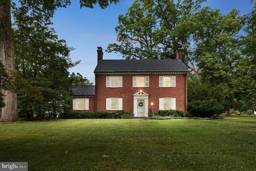 "Tradition lives in this classic Williamsburg colonial on main street, Oak Forest - Montrose Avenue! History buffs will marvel at the Flemish Bond brickwork, the 18' stone walls, the 3 wood burning fireplaces, custom built-ins, period-accurate 8 over 8 light windows, Royal slate roof with snow guards, wainscoting, crown & chair rail moldings, edge grain yellow pine & hardwood floors on the main and bedroom levels. Towering trees shade the two brick patios overlook the expansive back yard of the 3/4 acre, landscaped lot - plenty of room for that inground pool, tennis court - or both! The lower level family room offers a beautiful stone fireplace. Verizon FIOS & ADT alarm ready. Detached 2 car garage. The fixed staired walkup to the fully floored 3rd floor could be a 5th bedroom, office, gym or kids family room. The traditional center hall floorplan features a formal living room, formal dining room, and 1st-floor library/study/office. Master bedroom with his & her closets. Solid wood 6 panel doors throughout. Period hardware and moldings. Dutch door in the kitchen. Copper gutters and downspouts. Blue ribbon schools! Location, location, location.  Here's your chance to buy on Oak Forest's ""main street""!"