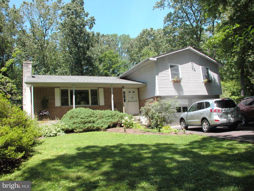 This home is ready for Summer fun with a 16 x 34 Kidney shaped Anthony Pool ready for your enjoyment.  Rural location within Green Lane Park and convenient to great boating and fishing.  Well maintained home on Cul-de-sac road with mature trees and private grounds.  The Family Room features a wood stove and walk-out to patio with adjacent decks to fenced pool area.  There is also a full basement for your finishing ideas.  Enjoy the newer Central Air Conditioning and wood burning fireplace in the living room.  Three bedrooms and two and one-half baths for your convenience.  Come out to the country and enjoy that ~away from it all~ feeling everyday~~