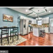 Come live in Historic Station East. Totally renovated home. 4 bedrooms including a master suite. 3 full bathrooms and a half. Open floor plan, gleaming wood floors, w/w carpet in the basement, stainless steel appliances, deck and parking pad.