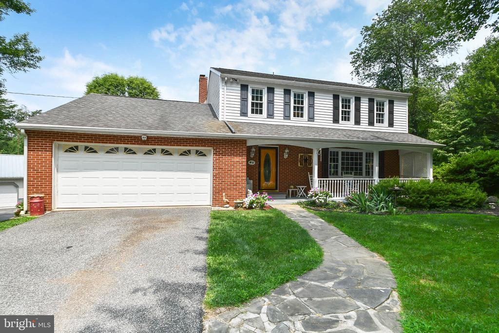 As Soon As You Enter the Driveway, You Will Feel Like You are a World Away, (Yet Just 7 Minutes to I-83), Relishing Your Scenic Vista. This Lovely Colonial Boasts Many Sought After Features.  Updated Kitchen has a Breakfast Area, Corian Counters, a Double Sink and Tile Flooring. There is a Separate Formal Dining Room  that Opens to the Living Room with Built-in Shelving.  The Main Level Family Room has a Wood Burning Fireplace and is Located Off of the Kitchen. The Sun Room is Off of the Dining Room for Ease of Entertaining in the Outdoors. Also Located on the Main Level is a Full Bath. The Master Bedroom has a Full Bath with Shower Stall.  The Second Bedroom has Been Opened to the Master to Utilize as an Office and is Easily Converted Back to Its Original Bedroom. For Your Convenience, the Laundry Room is Located on the Bedroom Level.  Hardwood Flooring Throughout. Ceiling Fans. The Lower Level has a Pellet Stove & Extra Space for Entertaining. In Addition to the Attached 2 Car Garage, There is a Detached 4 Car Garage, Which Could be Utilized for Your Car Collection, Stalls for Horses, Art Studio or that Passion Hobby You've Been Wanting to Pursue!  Attached to the 4 Car Garage is a Heated Workshop and Office Area**Whole House Generator**Underground Dog Fence**1 Year Home Warranty....So Much Value!