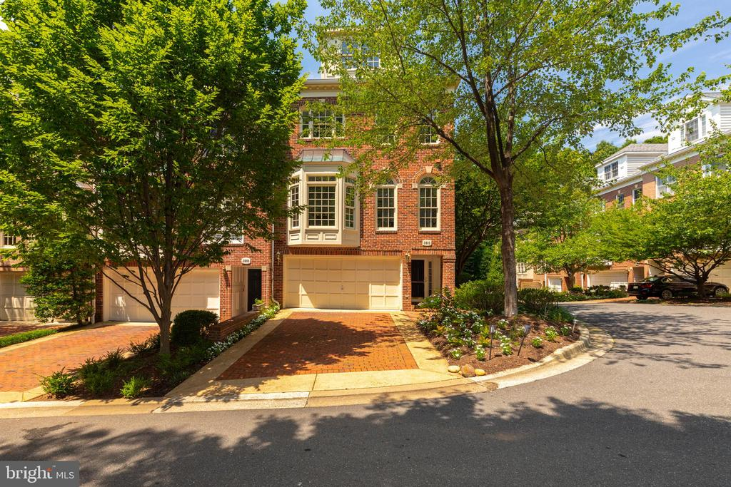 Stunning corner Eakin Youngentob townhouse in Hillandale with 2 car garage, 3BR, 4.5BA and two gas fireplaces.  Custom cabinetry throughout, new GE appliances.  Walk out lower level to deep landscaped garden and French Doors to deck off living room.  Shows beautifully.