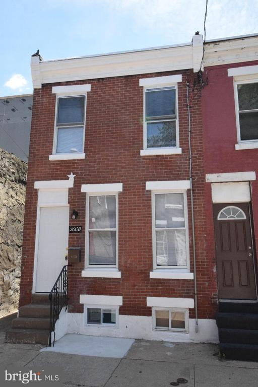 Immaculate and completely updated corner townhouse unit in Point Breeze! This property has been completely renovated and offers every amenity you need: brand New HVAC Lenox system, NEW windows throughout, NEW hardwood floors, NEW modern kitchen, NEW bathroom and much more. The first level includes a bright and spacious living room with updated Bruce solid oak hardwood floor, new modern fan with remote control and recess lights. The kitchen has been totally renovated with brand new 39~ solid wood custom cabinets with crown molding, black granite counters and beautiful bevel subway tile backsplash. It also comes with full stainless steel appliance package, including gas range, French door refrigerator, over the range microwave, dishwasher and a convenient breakfast bar. The main level also features a laundry room with NEW washer and dryer installed for your conveniences, and a fully fenced private backyard waiting for your peaceful enjoyment. Upstairs features 2 nice-sized bedrooms with new hardwood flooring and a new closet, plus a completely renovated full bath with new tiled floors, stylish curving tub with sliding shower doors, custom tiled shower walls to the ceiling, a beautiful pedestal sink and LED light fixtures. Other features include NEW Windows throughout; FULL fresh paint with neutral colors. FULLY finished basement with recessed lighting, new soft flooring and separate storage area, updated plumbing, electric system and newer water heater. Walking distance to Wharton Square Park, various shops and several public transportation routes in this rapidly growing area. 1-Year Home Warranty provided at settlement. A must see!
