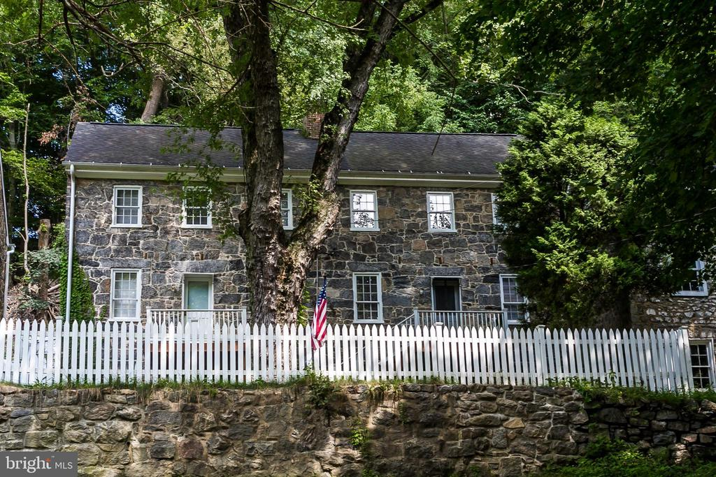 """""""I have been blessed with the opportunity to create out of this centuries-old stone duplex a new life as a single family home with a vaulted great room overlooking the Patapsco River. I can walk a couple of blocks to Main Street in Ellicott City and enjoy a hike along nearby parks and trail,"""" says Charles Wagandt, owner and well-known steward of many a historic property in and the Ellicott City community called Oella. Charles has much to say about history and the community yet remarks little of his family~s long legacy and accomplishment in the remarkable Milltown. Following in the footsteps of his great grandfather, William J. Dickey, Charles has spent a lifetime restoring and promoting rehabilitation of properties and buildings in the charming town. Driven by a passion for history and preservation, Charles has worked tirelessly with his family, his Oella Company, and others over nearly 50 years to bring Oella out of a past and to a renewed town with paved roadways, indoor plumbing and a vibrancy which can be felt in each of the colorful and pleasantly restored and new homes along the winding hillside setting of the community. Your best life begins in a place and with people who inspire. LIVE inspired in Historic Oella of Ellicott City. Buy or rent this iconic home. Available for sale for $595,000."""