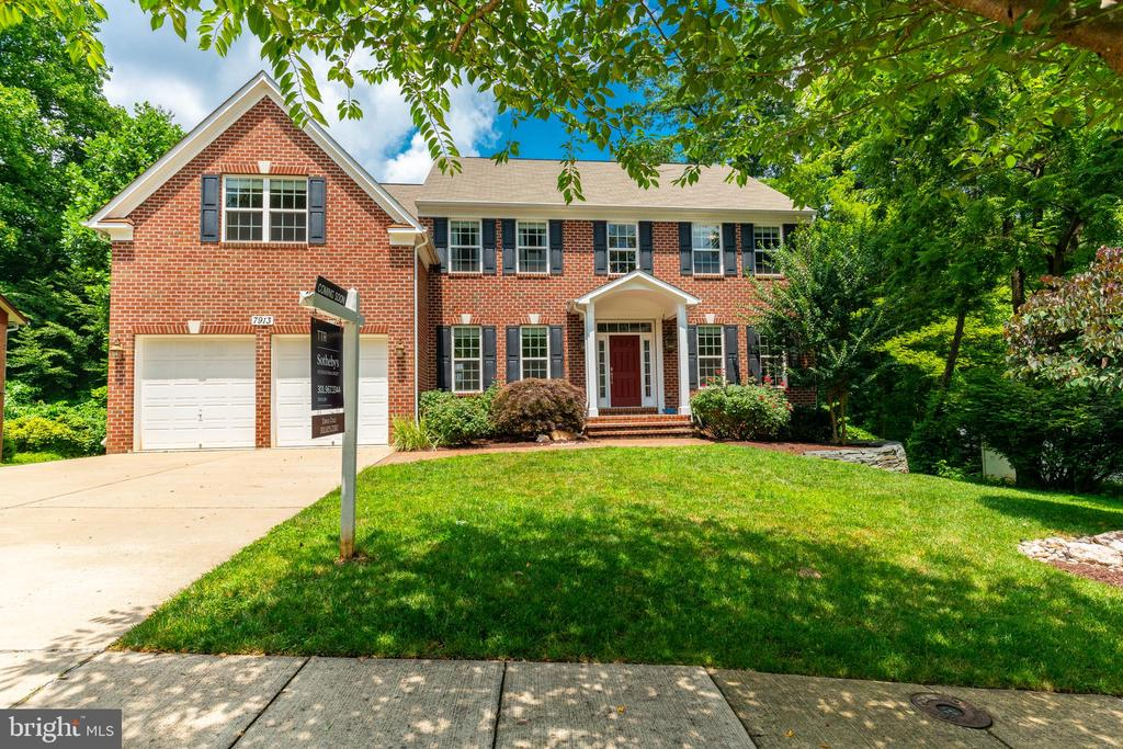 There's no place like Home. With its warm sense of community, walking distance to highly rated premier schools, & only moments away to shops, eateries & transport (easy access to 495, Chevy Chase, & DC) this custom built brick Colonial in sought-after neighborhood of Burning Tree Valley provides all the elements for relaxing, comfortable & easy-care living. The generously proportioned interior flows effortlessly from the open-plan living space to the spacious backyard with walkout basement & large stone patio. From the moment you enter, this home wows with a two-story foyer & dual staircase. Sleek & large gourmet kitchen with Wolf appliances & dual sinks flows through to your expansive family room with built-in entertainment center, as well as a warm & bright sunroom to enjoy your morning coffee or relax with family & friends. Luxurious bamboo floors are found throughout the main floor. Upstairs is highlighted by a substantial loft or second family room with one-of-a-kind & stunning treeline views of sunsets & annual fireworks display! Included in your owner's suite is a lavish bath with soaking tub and vast custom walk-in closet. A two-car attached garage off a private driveway comes with custom built-ins and organization leading into a large mudroom with additional built-ins. The living is easy in this impressive home with an even more impressive community. Welcome to your new home.