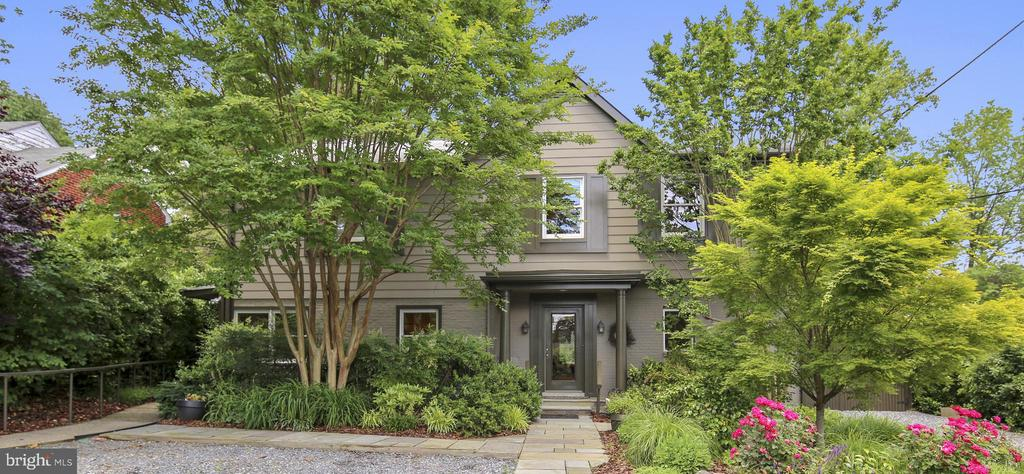 This stunning Bethesda/Chevy Chase home, located in the Edgemoor community, is a private oasis less than a mile from the heart of downtown Bethesda. An architectural expansion and renovation by Case Design produced a sophisticated and easy-to-maintain property, incorporating ideal features for a home office.             The MAIN LEVEL features a custom Kitchen with hardwood floors, granite counters & high-end integrated stainless steel appliances; a Living-Dining room w/ a gas fireplace; a Gallery Hallway, & a Great Room with a 10-foot ceiling opening onto a screened porch w/ gardens and a pool beyond. These features are conducive to elegant entertaining. The main level also includes three full bathrooms; an office/bedroom w/ pool access; a family room/bedroom with a custom media center;  wide halls and doorways. The Main Level is fully accessible from a four-room Disability Suite w/ a private entrance reached from the parking area.                       The UPPER LEVEL offers two Owner Suites. One suite has a large sitting area, spacious newly remodeled bathroom and a walk-in closet with access to a small finished attic. The other suite features cathedral ceilings, a separate dressing room, remodeled bathroom with double sinks, shower & soaking tub. This floor includes ample storage & a laundry room w/ full size washer-dryer.                                                         The LOWER LEVEL suite has a separate exterior entrance. It includes a full bathroom; a kitchenette; a large den/family room; built-in storage, and washer-dryer hook-up.                               The EXTERIOR presents as understated amidst seasonal greenery. The eco-friendly gravel parking area transitions to gardens, instead of grass, for easy upkeep. A range of garden settings and patios with retractable awnings and fountains provide multi-season living spaces. A large side patio is perfect for al fresco dining; a small private patio alongside the disability suite offers a tranquil sanctuary; and a large back garden features an in-ground heated pool, concrete surrounds with steps & ramps & a large canopied seating area w/ outdoor ceiling fans. Exterior lighting & power receptacles can be found throughout the property. Abundant storage & pool equipment are located behind attractive fencing. The house exterior is constructed of brick, HardiePlank siding & PVC moldings & trim for minimal maintenance.                 SUPPLEMENTAL INFORMATION: Case Design expansion and overall renovation occurred in 2003. In-ground vinyl swimming pool measure 14~ x 28~.  New pool liner, heater & energy-efficient pump.French-drains & a sump pump move excess water from the property. Landscaping includes specimen trees, perennial plants & flowers, paved walkways & fountains.                                KITCHEN APPLIANCES: Two Kenmore Elite dishwashers, KitchenAid Superba gas range, Sub-Zero counter depth refrigerator/freezer, and an Advantium oven.                                                      MECHANICAL SYSTEMS: Case Design installed plumbing, HVAC, roof, siding, exterior drainage Gas: stove, HVAC & fireplace. Electric: Supplemental HVAC, water heater, pool equipment WSSC water and sewer ~Cost-saver: to reduce sewer expense, the garden/pool water supply is separate from the main house system. Cable installed throughout. WiFi throughout, including side garden & pool area. SONOS wired first floor, side yard & pool area. Ceiling fans, skylights and recessed lighting.                            LOCATION/ACCESS: 0.8 miles to Bethesda Metro station (Red Line), 0.15 miles to Ride-On bus stops (#36 Bradley Blvd route, Bethesda Metro to/from Connolly School), 0.3 miles to Bethesda Circulator bus stop (free loop through downtown Bethesda), 0.3 miles to Capital-Crescent Trail (access near Arlington-Bradley intersection), 0.3 miles to Safeway and CVS 0.6 miles to the Bethesda Public Library, 0.6 miles to Bethesda Row Landmark Movie Theaters