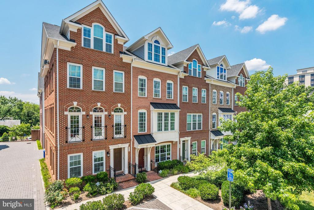 Stunning 3 Bed/3.5 Bath former model townhome located in the heart of Ballston - blocks to numerous restaurants, shops, parks, and the Silver/Orange line Metro. This all-brick home features four levels of luxury living that includes beautiful mahogany flooring, high ceilings, modern amenities, and custom finishes throughout. The thoughtfully designed open floor plan includes a designer eat-in kitchen, formal dining room, and living room creating the ideal space for everyday living and entertaining.  The upper-level hosts two generous bedrooms with en-suite baths including the master bedroom that offers spacious closets, spa-like bath with double vanity and walk-in shower. The loft area is complete with the third bedroom and en-suite bath, flex space with vaulted ceilings, and access to the private balcony. The lower level entrance conveniently features the welcoming foyer, home office, and access to the two-car garage.  Enjoy this prime location blocks to the new Ballston Quarter, True Food Kitchen, Ted~s Bulletin, Regal Cinema, and much more! Easy commuter access to Metro, 66, DC and Tysons.