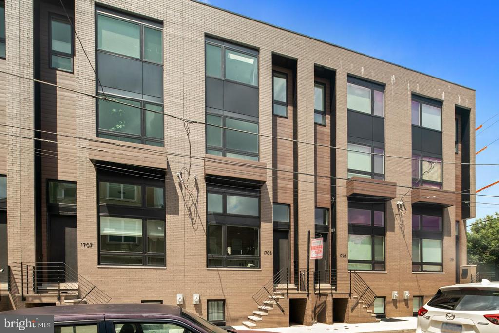 "Welcome to S17 development in Point Breeze! This one of a kind community consists of 6 homes each having a GARAGE off a shared drive aisle. As you walk up you'll notice the sleek facades with oversized windows that bring in an abundance of natural light into every corner of the home. Each 17' wide home includes dual-system HVAC, 3 bedrooms, 4 bathrooms and are carefully designed throughout. Starting in the lower level/basement you have a perfect area for entertainment. Pre-wired for surround sound along with 12-foot ceilings, you'll love to entertain your guests in this base. Basement also includes a full bathroom with a shower bench, seamless glass, and a floating vanity. As you go up to your main living room with 14-foot ceilings you have another half bathroom carefully designed underneath stairs above. Next half floor up your kitchen includes designer finishes with Samsung Appliances, custom cabinetry, honed quartz countertops, large custom pantry closet, with a large dining area. To make your kitchen even more unique you have your very own balcony for relaxing just a step away. As you go to the second floor you'll find two massive bedrooms with large closets with built-ins provided. Also on this floor is another large full bathroom with 52"" floating vanity and bath includes a custom glass accent panel to let in an abundance of light. The laundry room is located on the second floor with a high-end Samsung washer/dryer set. Entering your large master suite you will have stunning unobstructed views of the city skyline! Your master suite also includes a large walk-in closet with wall to wall built-ins and custom mirror. Your master suite also includes a den/office area. Master bath has an oversize floating double vanity, large seamless glass shower with floating bench, also a freestanding tub with custom skylight above. Finally your roof deck provides one of the best views in the area, something you have to see for yourself to really appreciate. The S17 development is centrally located with close proximity to Center City, Rittenhouse Square, East Passyunk, I-95, I-70, University City and much more. Come to take a walk through before they are all gone! 10-year tax abatement, one-year builder warranty!"