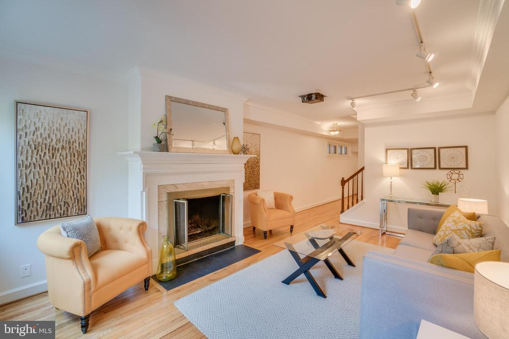 This charming townhouse style condominium in little known Eton Court is move-in ready.  Features include newly refinished oak hardwood floors, wood-burning fireplace, two bedrooms, and two full baths and abundant natural light.  The traditional layout is ideal for entertaining with a formal dining room and 1st-floor bath for guests.  On the 2nd floor, there are two bedrooms, one full bathroom, and abundant closet space.  Additionally, there is a full 500SF+ basement perfect for storing anything. Eton Court is centrally located in prestigious Georgetown, mere steps to all of Georgetown~s shopping, dining, entertainment, the Capital Crescent Trail and C&O Canal.  The community occupies a half block which is bordered by M St. NW (to the South), 33rd St. NW (to the West) Potomac St. NW (to the East) and Prospect St. NW (to the North).