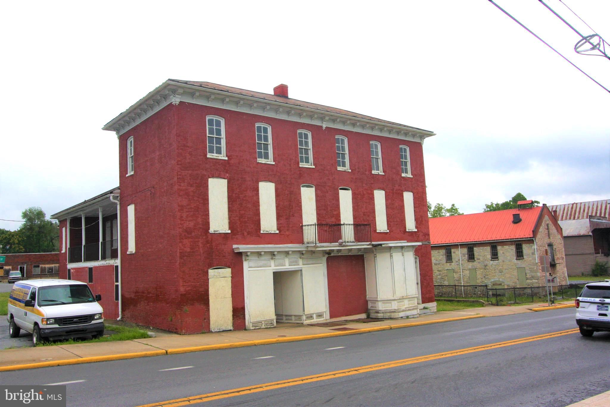 Available now for the first time on the open market in many years is this grand historic property with exceptional curb appeal in the heart of historic downtown Martinsburg.  Vacant for many years, this property eagerly awaits a new owner's vision for restoration.  Located in a historic district and a federal Qualified Opportunity Zone, this property may provide the new owner with significant tax benefits, as well as joy of ownership.  Historically used as commercial on the ground floor and residential above.  Close to MARC train with view of historic locomotive train round house.