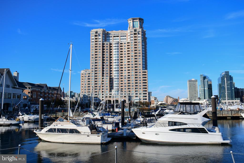 Magnificent Inner Harbor Waterfront Condominium & Yacht Club!!!  Newly Updated two bedroom, two Bath over- looking Marina. Indoor & Outdoor Swimming Pools, Hot Tub Saunas, Olympic size Gym, New Party Rm w Bar & Table Pool,  24 hr Front Desk Service. Lowest priced 2 b/r. Special assessment will b pd by seller.   Walk Promenade to Inner Harbor Attractions, Museums, Restaurants and Entertainment!   Luxury Living Overlooking Inner Harbor& Marina living  at its Finest!!!