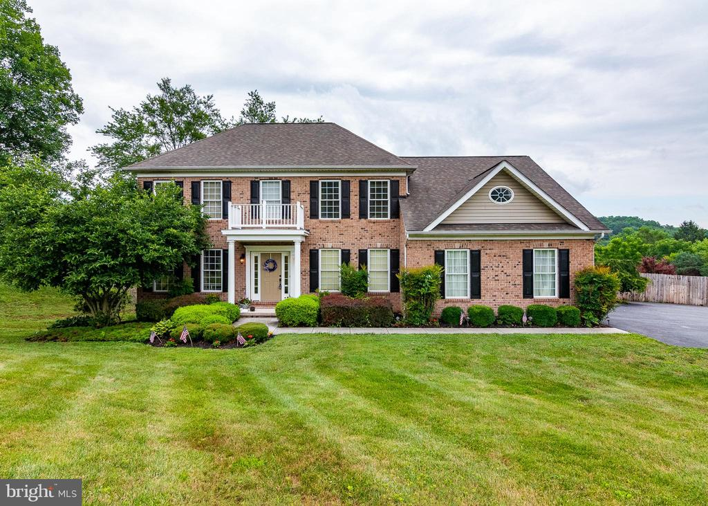 """3,000 dollars agent bonus with ratified contract before 8/30/19! """"When I saw you, you took my breath away."""" Amazing rolling hill views with 1.42 acre lot, overlooking a new heated in-ground salt water pool with a fenced in yard. 2 gas fireplaces, fully finished walkout basement, open gourmet kitchen leds to the family room that's perfect for entertaining, composite decking, master suite, updated bathroom, in the Hereford Zone Schools."""