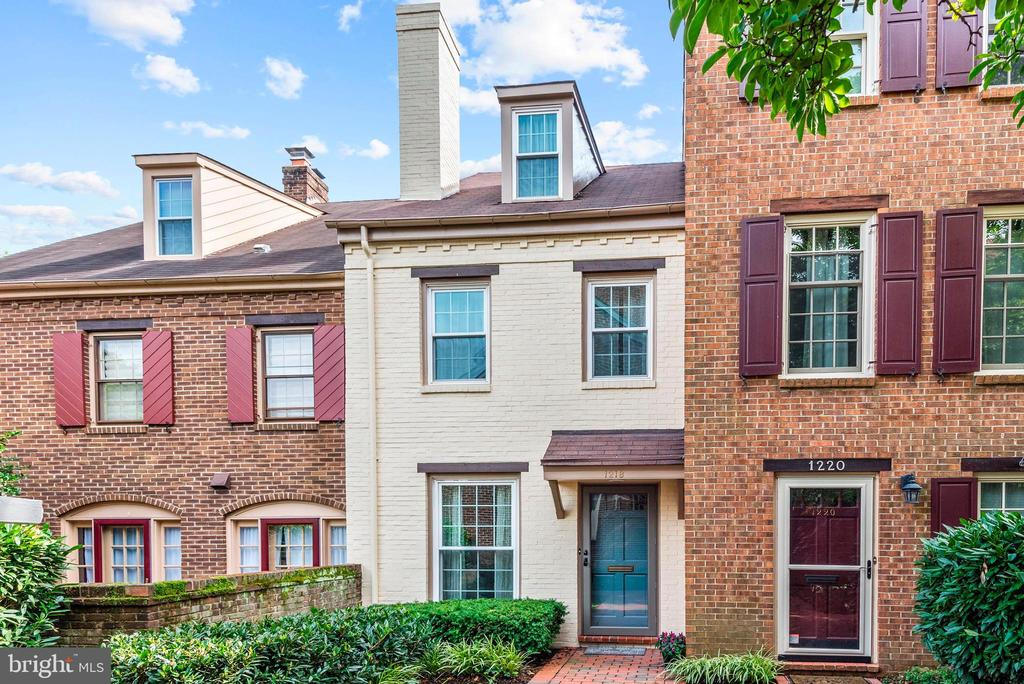 Modern flair is combined with Old Town Alexandria sophistication in this stunning brick three level townhome. Located in a quiet courtyard setting in N. Old Town, this town home has been completely renovated from top-to-bottom with designer finishes. Features include the gourmet kitchen, updated bathrooms, recessed lighting, hardwoods throughout, two master bedroom suites, two working fireplaces and ample closet space. Brick backyard patio for grilling. Community parking at your door. Incredible location-1 stoplight to DC, walk to the best of Old Town and Braddock metro. Steps to Slater~s Lane shops and restaurants. Enjoy the GW trail, parks and the waterfront. Don't miss it!