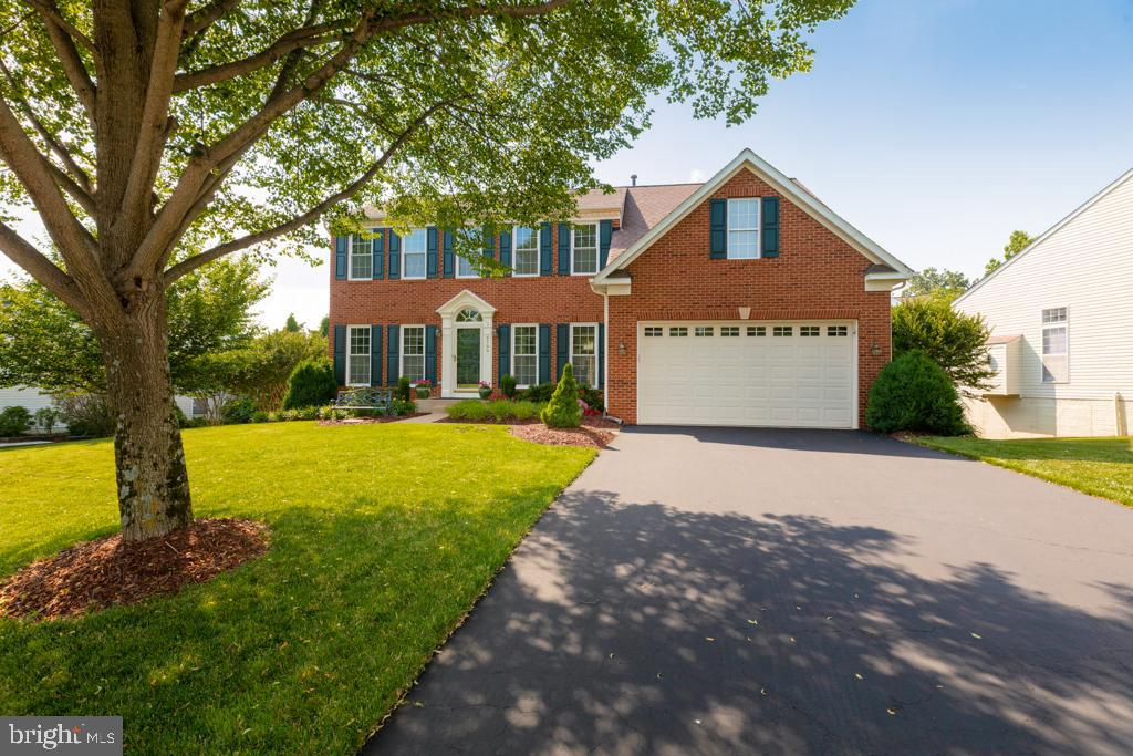 """Welcome to 8566 Fisher Woods Drive.  This stunning colonial situated on over a quarter-acre lot in the Mount Air community has over 4,000 square feet of living space and has been impeccably maintained.  The bright and airy family room offers a wall of windows and a cozy fireplace.  The spacious eat-in kitchen features Corian counters, 42"""" cabinetry, recessed lighting, and matching white appliances.  Just off the kitchen is a spectacular deck and screened-in gazebo overlooking the expansive fenced-in rear grounds.  On the lower level you""""ll find a spacious rec room, a full bath and a sizable storage room.  From the pristine hardwood floors on the main level and enhanced moldings, to the 7-zone irrigation system, this residence has it all! Ideally located just a short drive to Fort Belvoir, all commuter routes, Kingstowne and Springfield Towne Centers and Wegmans."""