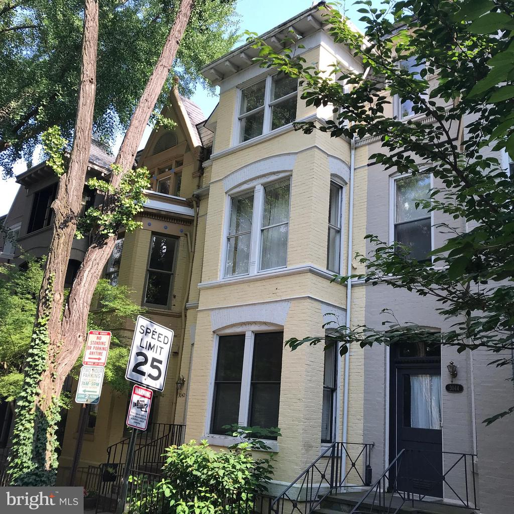Fabulous location! House located on quiet one-way street in Georgetown's East Village, close enough to walk everywhere but far enough away from noise disturbance, traffic and parking challenges. 4 level row home features 5 bedrooms, 3 full bathrooms a formal dining room and an open concept kitchen living area. Exposed brick and a  wood-burning fireplace add to the charm. A large terrace on the 2nd floor off the home office with built-ins allow al fresco dining and is great for entertaining. The lower level features an in-law suite with separate entrance adjoining a family room which leads to the home's private patio in the back of the house. The home doesn't provide off street parking but it is easy to find a spot on the street. Owner prefers a multi-year lease.