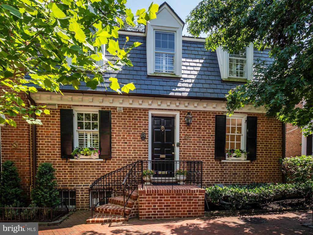 Light filled semi-detached Georgetown home with outdoor brick patio perfect for entertaining.  Traditional main level floor plan with hardwood floors throughout, living room with wood burning fireplace, dining room off updated kitchen featuring stainless steel appliances.  Powder room on main level, ample storage and built-ins, 3 bedrooms, 2 bathrooms up, 1 bedroom with full bathroom on lower level.  Lower level includes den/family room with wet bar & fireplace, plus rear access to patio.  Short walking distance to Georgetown University, Wisconsin Avenue and M Street shops & restaurants.