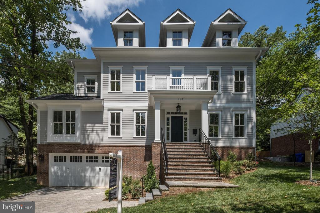 """**Springstreet Development presents a refreshing revival of a classic Arlington colonial in this new Lee Heights home.  With """"two lights to DC convenience,"""" walkable to shops, restaurants, and parks plus within Donaldson Run pool boundaries.***                                                               Sunfilled main level offers den with en suite bath for 6th BR if needed;  traditional living and dining rooms; family room flowing into kitchen with center island, abundant cabinetry and quartz countertops, 6 burner gas range, separate wall oven, and walk in pantry.    Appealing master bedroom with oversized shower and separate tub for relaxing, double bowl vanity, stylish tile, accessories. Daylight lower level with 5th private bedroom, bath, gym, and expansive rec room/second family room, and all important storage.   Walk to Lee Heights shops, restaurants, parks, and bike lanes along Lorcom Lane to verdant bike trail.  Taylor, Williamsburg/Dorothy Hamm (early 2020) and Yorktown schools."""
