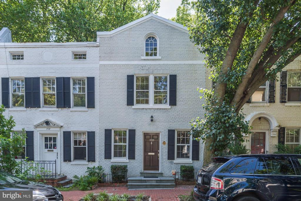 As you enter this 1790 square foot Georgetown historic Federal rowhouse from 1922 you will find a completely renovated home blending historic with contemporary.  On the main level you will have a nice open living room and a large kitchen great for anyone that enjoys to cook or entertain. The kitchen has granite counter tops and top of the line stainless steel appliances. Off the kitchen there is a dining room with a view of the private backyard.  Upstairs you have 3 bedrooms with two tastefully renovated bathrooms.  The basement has been fully finished with a wet bar and full bathroom.    From the walkout basement you will head into the backyard where there is a brick patio and a heated pool.  Pool maintenance is included.  The home has central AC and heated floors on every level. 1 block to bus stop to Union Station. Convenient to Georgetown University, Georgetown Hospital, Safeway, Wholefoods, Starbucks, restaurants, nightlife and much more!