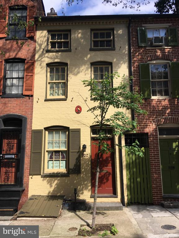 This historic row house on the quiet, tree lined block of Tyson Street has the classic dimensions of 11.5 feet wide and 58 feet long on the first floor. An old ships ladder curving staircase leads to the upper floors. A large multi-level deck from the second floor that is accessed through a large butler window.  This home features three bedrooms, 1 1/2 bathrooms, living room, dining room and newly remodeling kitchen with all new appliances, central heat/air and inside washer and dryer all while still maintaining its old world charm and features. Interested in outside entertaining? Then you will appreciate the upper deck and backyard patio. Parking is with permit. One for occupant and an extra one for visitors.Want to go somewhere? It's an easy walk to Baltimore Penn Station and steps from the Light Rail, Metro Subway, and the Hopkins Shuttle. Want to stay in the area? This location is within walking distance of Mt. Vernon's historic and cultural arts district. This includes the Symphony Center, Opera House, museums and the Peabody Conservatory.