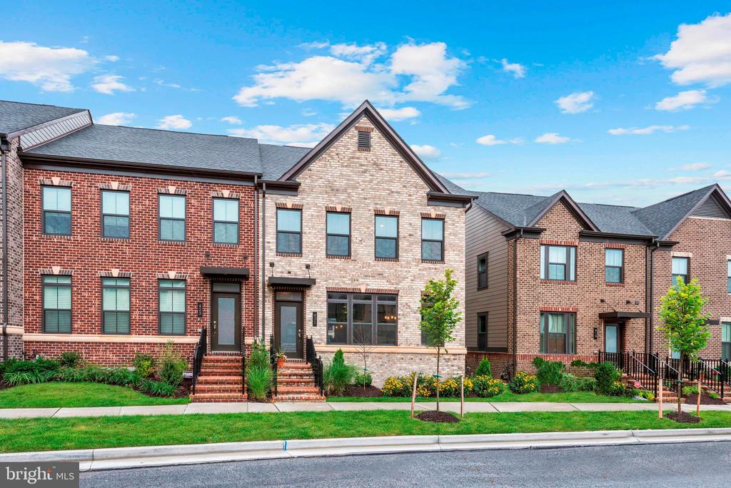 Gorgeous end unit open concept townhome with modern sophistication! Step into the foyer and past the main level powder room and arrive in the dining room highlighted by  a picture window, open shelving, and gorgeous hardwood floors that flow throughout. Prepare gourmet meals in the kitchen boasting massive center island with breakfast bar, pendant lighting, 42~ cabinetry, stainless steel appliances, Herringbone backsplash, and granite counters.  Entertain in the spacious living room with recessed lighting, double transom windows, and  access to the private patio and deck area.  Relax and unwind in the master suite with tray ceiling, custom blinds, double vanity, walk-in closet, and glass door walk-in shower with double bench and surrounded by ceramic tiles.  Possibilities are endless in the fully finished lower level that offers plush carpet, additional bedroom, and full bath that provide an ideal space for a guest suite. Community pool, fitness center, and club house provide an entertaining paradise. Major commuter routes include White Marsh Blvd, US-40, I-95, and I-695.