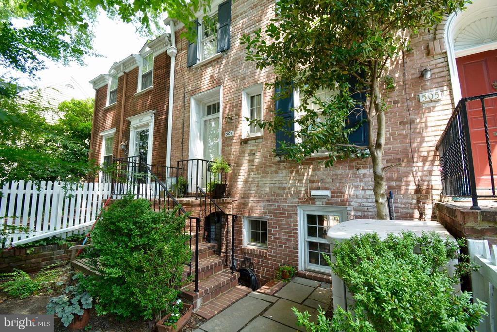 OPEN HOUSE Sun July 21, 2-4  Totally charming 3 level townhouse w/2 bedrooms and 1.5 baths. This home has large windows allowing in lots of light, 2 decorative wood burning fireplaces, a lovely front yard and a magic patio garden with privacy and a canopy of mature trees. The large master bedroom has 2 closets and 2 skylights. The living room has hardwood floors, built-in cabinets & bookcases a large window and a small office niche. Super convenient location with walking distance to schools, shops, restaurants & public transportation and easy parking.