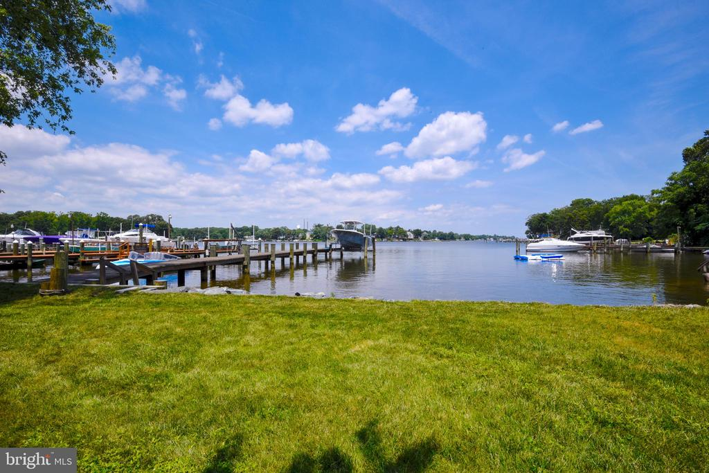 THIS LISTING IS TRULY A ONE OF A KIND WATERFRONT COMPOUND CONSISTING OF THE MAIN WATERFRONT HOME W/4 BED/2 FULL BATHS, A SECOND COMPLETELY INDEPENDENT HOME FEATURING 1 BEDROOM/1 FULL BATH THAT BRINGS $1100 PER MONTH. PLUS A SEPARATE WATER VIEW BUILDING LOT. THE LAND IS MADE UP OF 2 SEPARATE LOTS (TAX #020356002291600 & #020356090001006) THAT TOTAL JUST OVER 1 ACRE. BOTH HOMES HAVE BEEN COMPLETELY REMODELED WITH A TOTAL FINISHED SQ. FT. OF ALMOST 2800. WATERFRONT FEATURES A NEW 100' PIER, 10,000 LB. LIFT, JET SKI LIFT AND A BULK HEAD/RIP RAP SHORE LINE. PLUS 4TH OF JULY ON STONEY CREEK IS PHENOMENAL. EVERYWHERE YOU LOOK INCLUDING 3 PIERS AWAY WITH A STATE OF THE ART SHOW. TOO MANY OPTIONS AND UPGRADES TO MENTION. THIS IS A MUST SEE PROPERTY. BACK UP GENERATOR INCLUDED. OPPORTUNITIES ARE MANY WITH THIS PROPERTY. BUILD A HOME ON THE EXTRA LOT AND YOU COULD HOUSE SEVERAL GENERATIONS WITH IN THE FAMILY OR SIMPLY RENT OUT BOTH HOUSES AND SUBSTANTIALLY REDUCE YOUR MONTHLY COST OF LIVING ON THE WATER. SELLER IS A LICENCES REAL ESTATE AGENT!