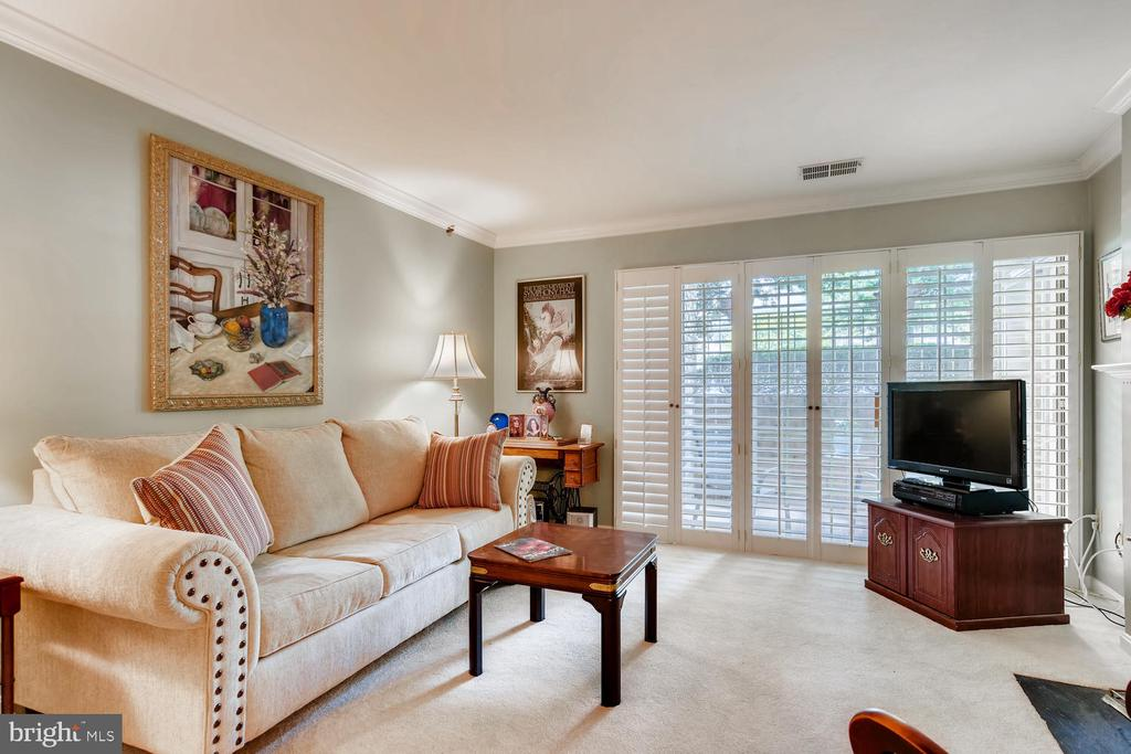Charming ,Bright and Cheerful, Freshly Painted Throughout, New Carpeting, Updated, Bathrooms, New, Kitchen Flooring, Wood burning Fireplace, Plantation Shutters all for your comfort and enjoyment.MOVE IN READY