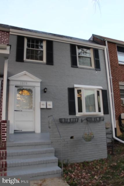 Very unique 2 br. 1 bath condo located within the pictured town home.  Located close to St. Agnes hospital . Lower level welcomes you to a updated kitchen with granite counter tops and space for a dining room table joining room has a Washer and dryer located in the basement.
