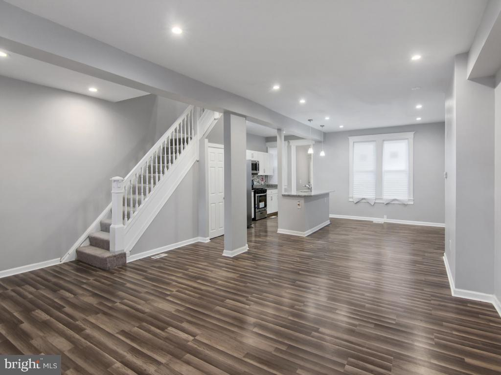 PRICE IMPROVEMENT!!! Beautifully renovated Better Waverly townhome with 3 bedrooms and 3  full bathrooms!!!  Open concept main level, Stainless Steel appliances,  Fully finished lower level!!!  Perfect location to take advantage of amenities and city incentive programs - Live where you work.  Home Warranty with full priced offer!!!