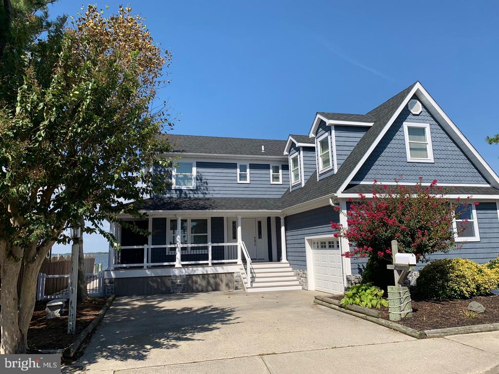Ultimate Bayfront Dream Home. Major Upgrades through out  in 2018. 2 Boat Lifts. Gas Fireplace. Gas heating on first floor and Heat Pump on the second floor. Additional Bedroom  above Garage with Separate Bath.  Upgraded Vinyl Floors Throughout, except in bedrooms which has plush carpet. New Bulkheading installed in 2018.   Out side storage for your boating equipment. Watch the Fireworks Display at North Side Park from your private deck.