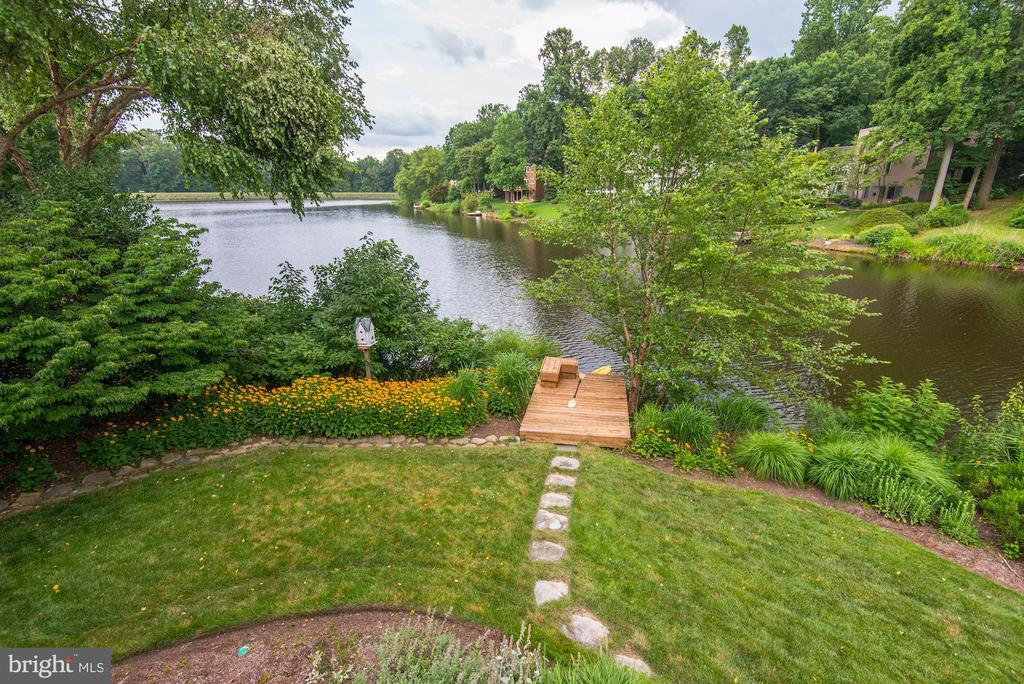 Awesome view on Lake Newport, in the most desirable part of North Reston.  This spectacular home combines the best of contemporary architecture with waterfront amenities that provides serenity and tranquility to its homeowners and guests.  Great views of the lake from the living room and dining room with a fireplace in between.  Soaring windows and vaulted ceilings.  Renovated kitchen, stainless steel appliances.  Office in main floor, which can be used as a bedroom.  Lower level offers a rec room with a wet bar, den and full bath.  4 spacious bedrooms upstairs and 3 full renovated baths.