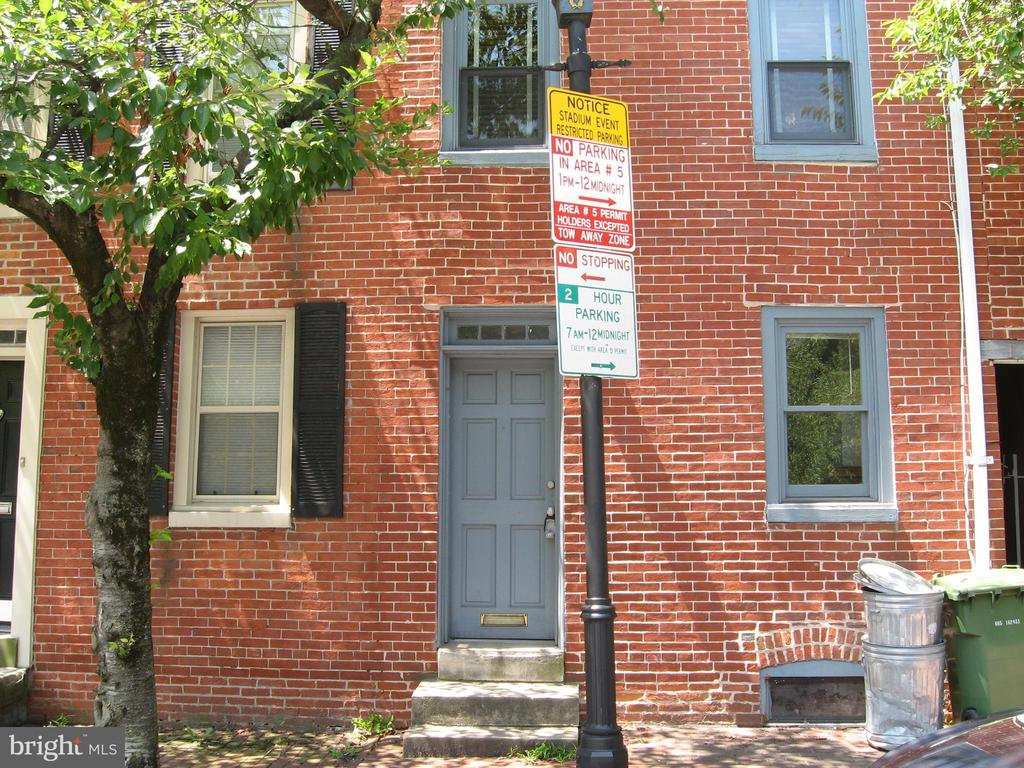 2 bed 1 bath row home with granite counter tops, SS appliances & fireplace in the living room located in Ridgleys Delight directly across from Camden yards. Conveniently located to downtown, UMAB & BW Parkway & 95.