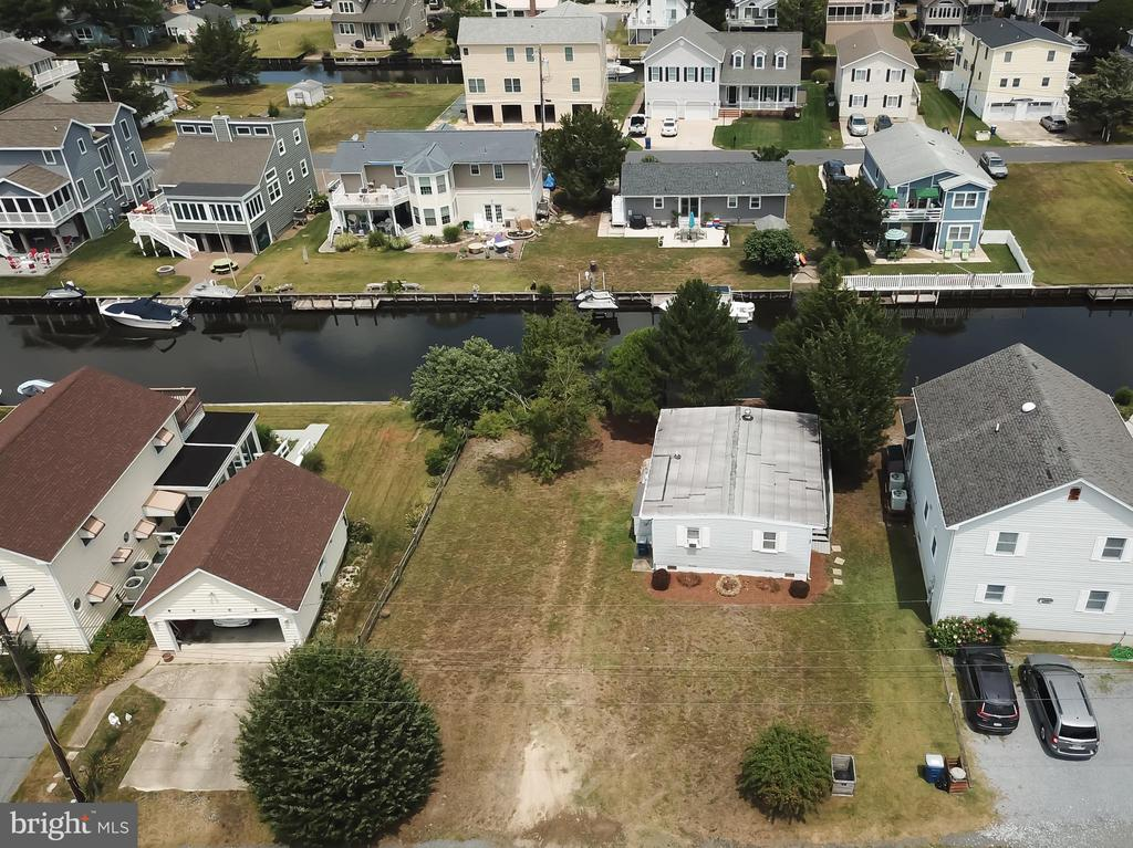 BEST RPICE for oversized building lot  w/livable small cottage already there in South Bethany!  Enjoy the coastal life style in the 2 bd/1bth remodeled cottage, and then build a larger home of your design in time.  Easy boating, walking distance to guarded beaches.  Enjoy the boating, crabbing, and fishing in your back yard. Good potential rental income also! Property is also listed under land DESU146060.