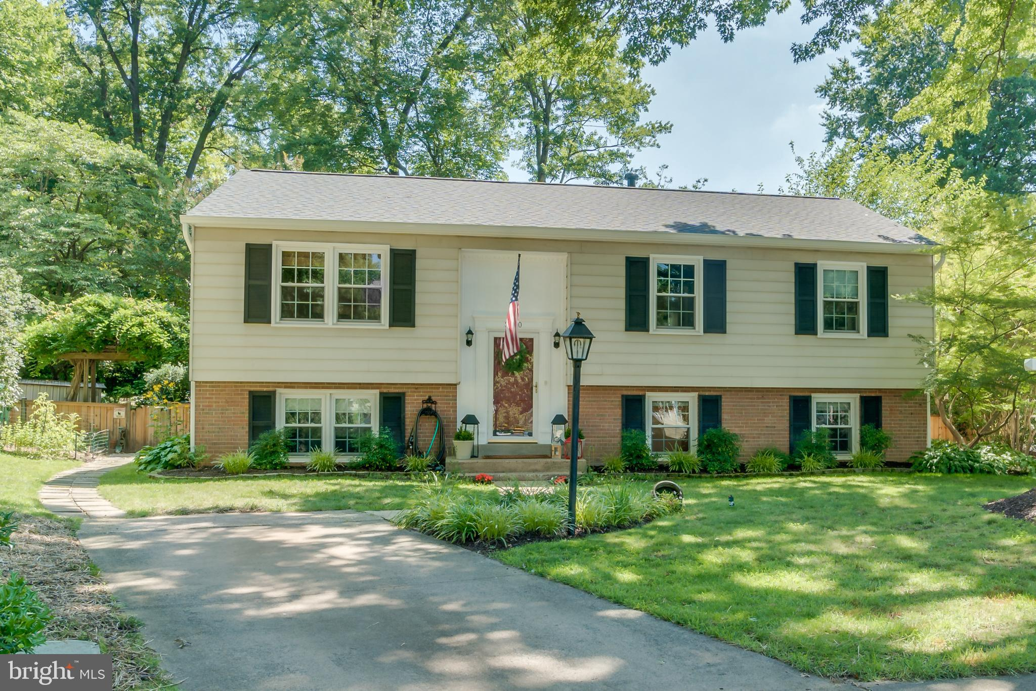 Gorgeous and unexpectedly large split foyer tucked away on a secluded cul-de-sac in Stoneybrooke.  This home has been meticulously maintained and features new for 2019 updates including lighting, faucets, bathrooms,  roof and gutters.  Renovated kitchen with custom Omega cabinetry featuring soft close drawers,  pantry cabinet with pull out shelves, mullion doors and granite counters.  Large counter height peninsula island perfect for entertaining.  Oak hardwood floors cover the main level living, bedroom floors, and lower level recreation room.  High efficiency vinyl windows throughout.  Master Bedroom features newly updated ensuite bath with white subway tile. Upper level full bath features updated lighting, white subway tile, faucet, white vanity and cast iron bathtub.  Huge lower level recreation room with ample room for large cozy furniture.  Lower level full bathroom and bedroom with private sitting room make for the perfect Au Pair or In law suite. Large partially finished laundry and utility room with plenty of extra storage space and walkout to side yard.  Enjoy the great outdoors in the exquisitely landscaped fully fenced yard. Mature shade trees provide respite from the summer heat and the large flat lawn is encompassed in beautiful gardens of colorful perennials  including black eyed-susans and hydrangea bushes. Pass through the wisteria draped gate into the corner secret garden with a flagstone patio and wrought iron bench waiting for you to bring a good book and a cup of tea.  Relax on your maintenance free Trex composite deck with new friends and old.  Community features playground, basketball court, tennis courts, and covered eating near the park. Stoneybrooke residents are welcome to join Virginia Hills Pool less than a mile away. Multiple shopping centers and restaurants are within 3 miles. Only a 10 minute drive to Huntington Metro where you can take the yellow line direct to Old Town Alexandria, Reagan International Airport, National Landing (Amazon HQ2), Pentagon and into the District.