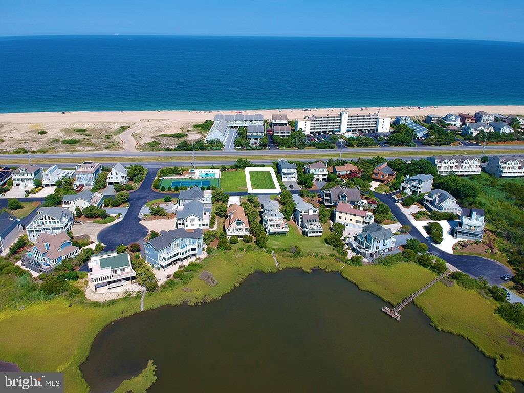 Build your dream beach home on this exceptional property just steps to the beach. Overlooking preserved State Park land assures your Ocean views will remain untouched and you have the potential for bay views from upper levels. Enjoy the best of both worlds being tucked between the Ocean and the Bay with easy walking access to both. Located just outside the quaint beach town of Fenwick Island in the community of Seatowne, offering a pier for kayak launching, tennis and a brand new swimming pool.