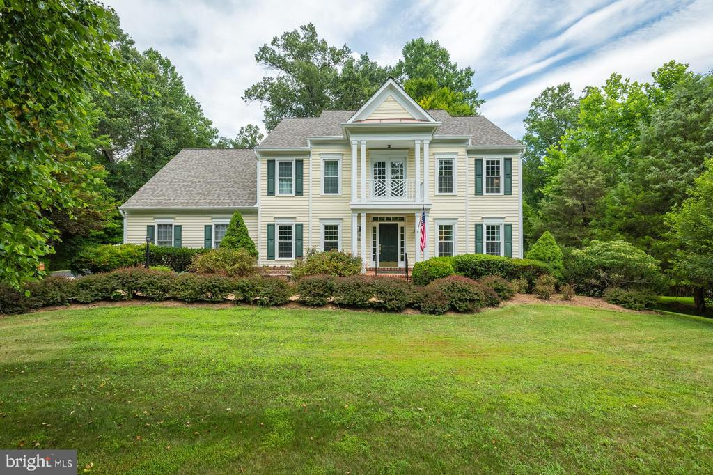 Welcome to this Stunning 5,100 sqft colonial home on over an acre backing to woods. Hardwood floor, New carpet, Fresh paint, 5 bedrooms, 4 full bath home with bonus room on the second floor.  The first floor bedroom is a plus. Library has custom mahogany wood book cases.  The sunroom which overlooks the beautiful and serene backyard is a show stopper.... Kitchen is a chefs dream opens to the family room. Check out the work shop/storage room... Minutes away from Harris Teeter and Commuter parking lot. Bring your offers fast because this won't last!