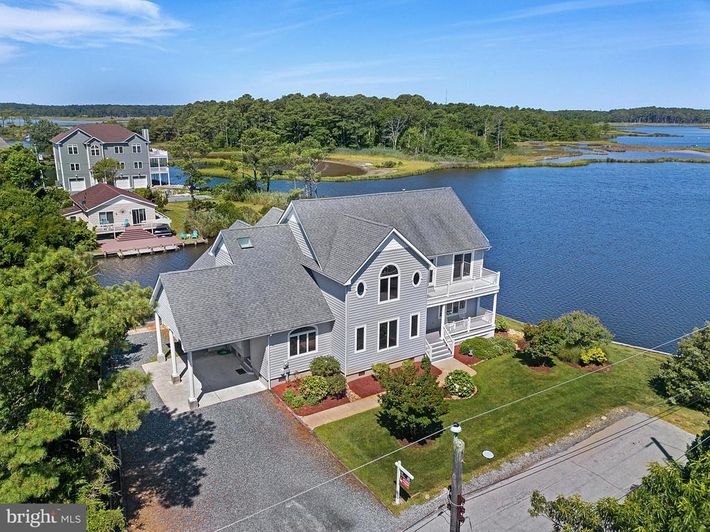 """PANORAMIC WATER VIEWS!  This custom built home sits on a large lot overlooking Jefferson Creek and """"Rabbit Island"""", an unbuildable 12 acre island rife with shorebirds of all kinds!  Almost 200' of bulkhead surround this home including your own private boat ramp!  Perfect for boaters of all kinds!  Inside you will find an open floor plan with lots of windows to allow for plenty of natural light and water views.  There are 2 bedrooms downstairs and 3 upstairs - each with their own full bathroom!  There is lots of storage to be found in this 3472 sq ft home and even more room to grow - there are two unfinished areas upstairs that can be used to expand this home!  Granite countertops, stainless appliances, outdoor shower, storage, sprinkler system, screened porch, balconies are just some of the upgrades you'll find in this Coastal gem!  This home is not a rental property but has excellent rental potential, for those who are interested in an investment property!  Contact me for more information or to make a showing appointment!"""